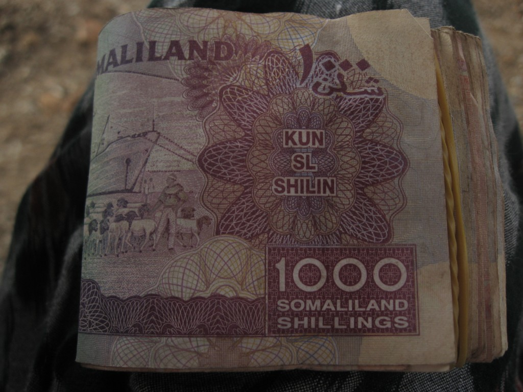 6,000 SOS (Somaliland Schillings) equal a dollar. The hens were about 25,000 and the roster was around 15,000
